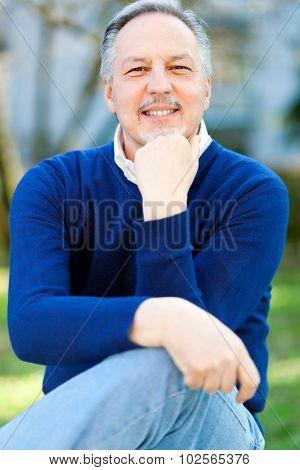 Happy mature man at the park