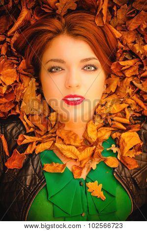 Portrait Of Young Woman In Autumn Leaves.