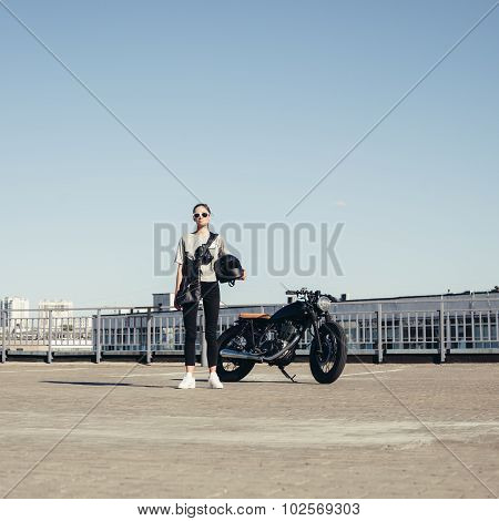 Sexy Woman With Old Fashioned Motorcycle