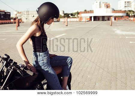 Biker Girl Sitting On Vintage Custom Motorcycle