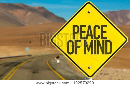 Peace of Mind sign on desert road