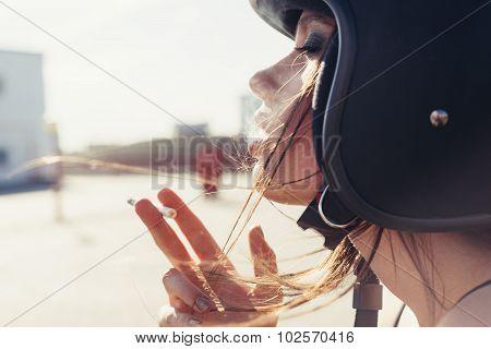 Beautiful Woman In Motorcycle Helmet Smoking Sigarette
