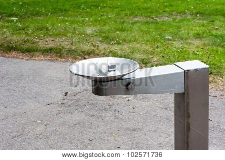 Metal Drinking Fountain In Park