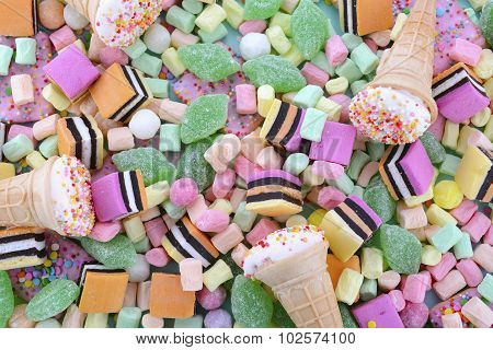 Bright Colorful Candy On Pale Blue Wood Table.