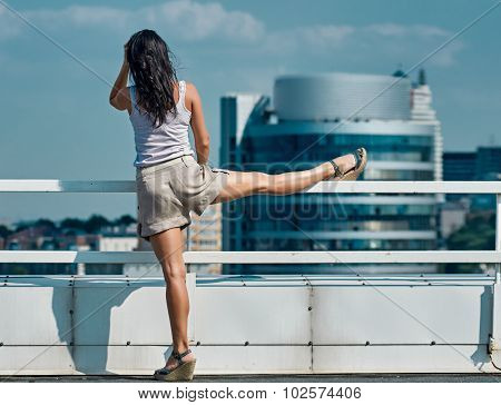 Fitness woman stretching city