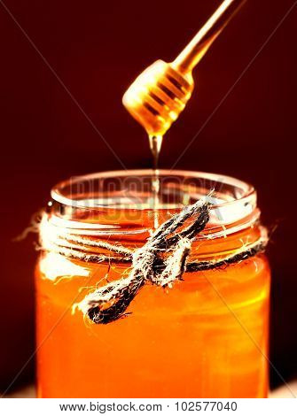 Fresh Honey In Jar With Honey Dipper On Vintage Wooden Background Close Up