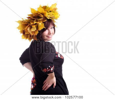 Brunette Girl With Garland Of Yellow Leaves