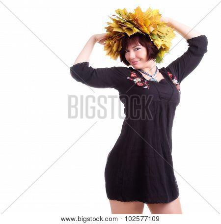 Brunette Girl Plays With Garland Of Yellow Leaves On Head
