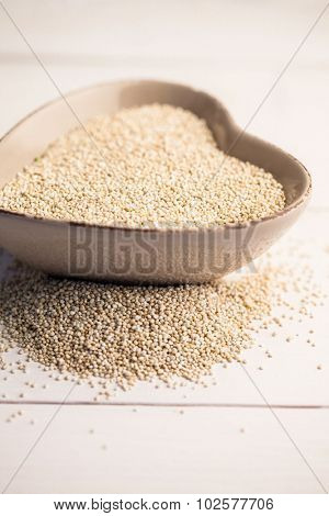 Cropped image of sesame seed in heart shaped bowl