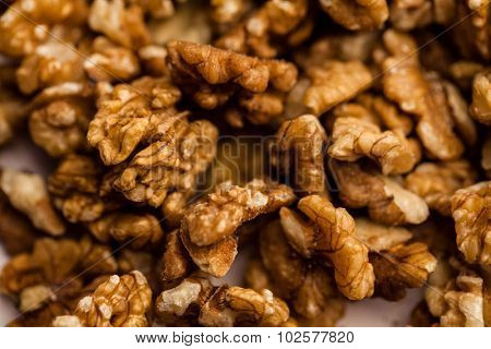 Full frame shot of walnuts scattered on the table