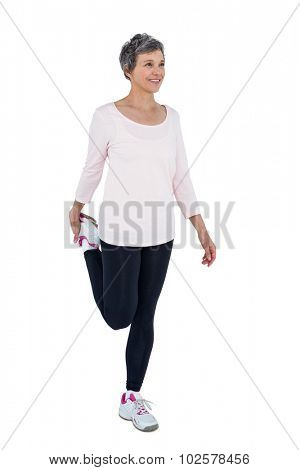 Mature woman exercising over white backgrounnd