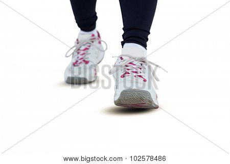 Low section of woman wearing shoes against white background