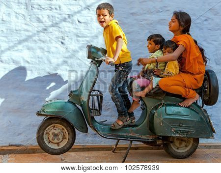 An Unidentified Indian Children Play With An Old Scooter In Jaisalmer Fort, Jaisalmer, India.