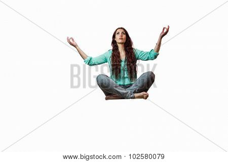 Full length of woman levitating with arms raised against white background