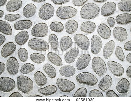 A wall of large rounded boulders with white joints