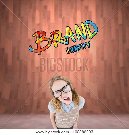 Confused geeky hipster woman against curved wooden room