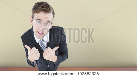 Geeky businessman with thumbs up against room with wooden floor