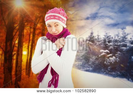 Attractive woman wearing warm clothes against autumn changing to winter
