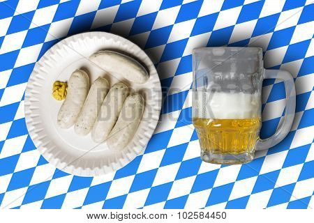 Traditional Bavarian Sausages On White Plate And Beer In Front Of Bavarian Flag