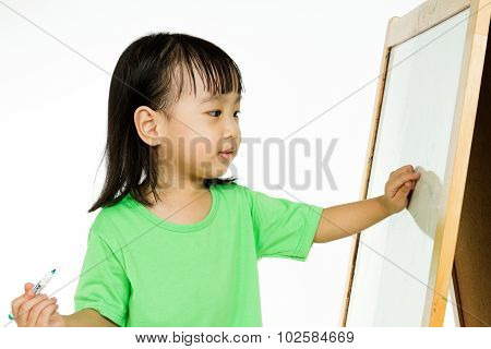 Chinese Little Girl Writing On Whiteboard