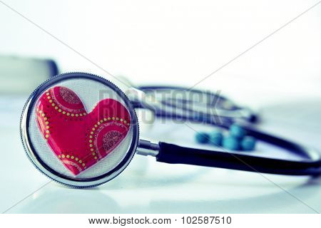 closeup of a red heart on a stethoscope for the cardiovascular health