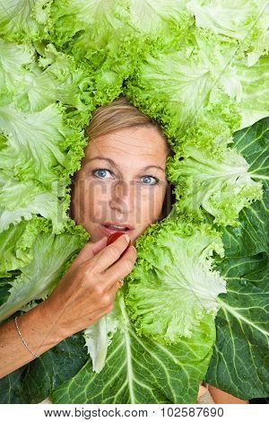 Cute Woman With Salad Leaves Arranged Around Her Head
