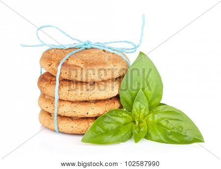 Stack of crackers with basil. Isolated on white background