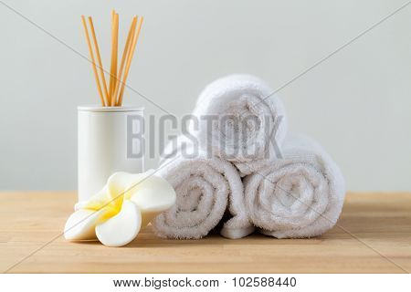 Tropical flowers frangipani with Scented woods and white towel for thai massage