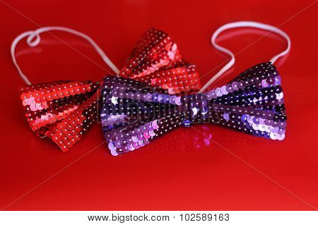 Red and purple tuxedos on the red background