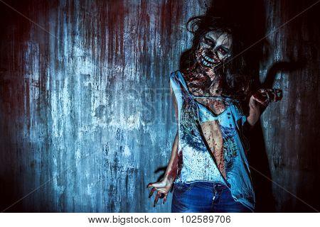 Furious bloody zombie girl. Horror. Halloween.