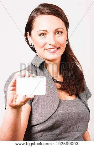 Nice woman with clear white card in her hand