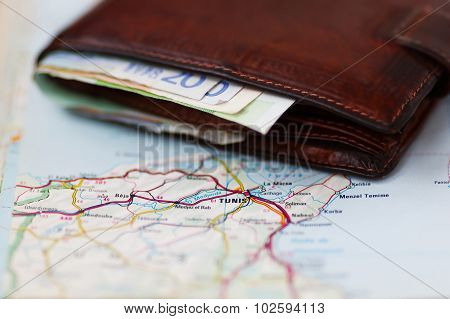 Euro Banknotes Inside Wallet On A Geographical Map Of Tunis