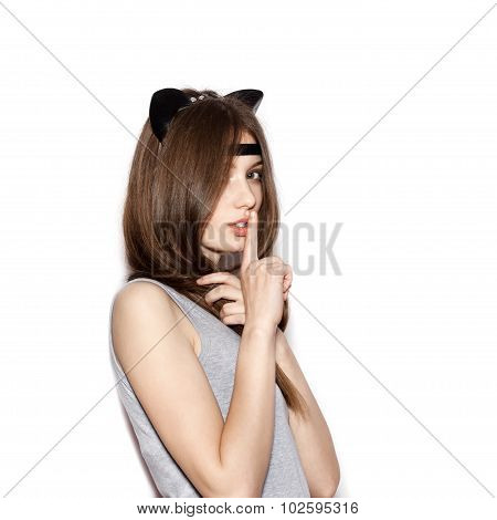 Woman With Dark Hair Keeping Her Forefinger By Lips