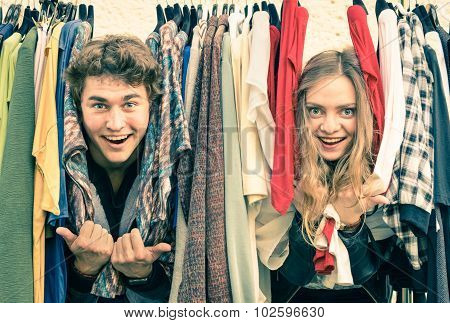 Young Hipster Couple In Love At The Weekly Cloth Market - Best Friends Sharing Free Time Having Fun