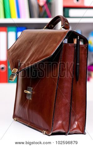 Brown leather briefcase on the table at office