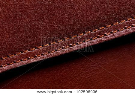 Leather background or textures. Close up on a leather texture with a linear stitch.