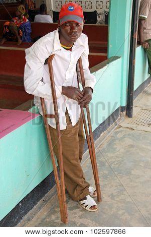 An African Boy On Crutches In The Iringa Hospital, Tanzania, Africa