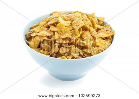 Corn flakes in blue bowl isolated