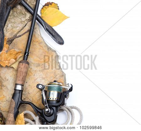 Fishing Rods On Stones With Anchor And Leafs