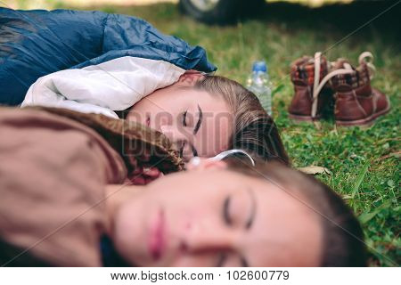 Women resting in the nature inside of sleeping bags