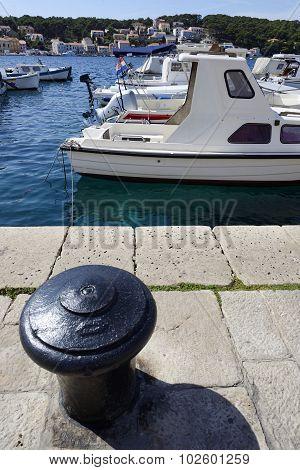 Iron Bollard And Boats In Mali Losinj, Croatia