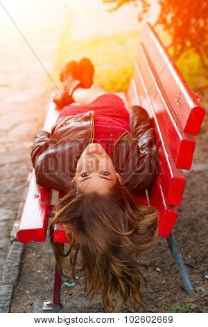Ng Girl Lying On A Red Bench With Long Hair Back