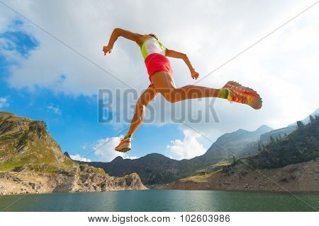 Skipping Girl As He Runs Near A Mountain Lake