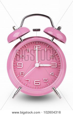 Pink Alarm Clock With Hands At 3 Am Or Pm isolated on white background