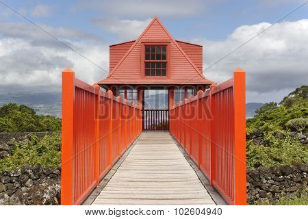 Red Wooden Viewpoint Pathway In Pico Island Vineyard. Azores. Portugal