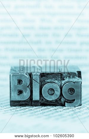 the word blog written with lead letters. symbolic photo for blog