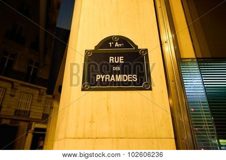 PARIS, FRANCE - AUGUST 11, 2015: street sign on Paris building. Paris, aka City of Love, is a popular travel destination and a major city in Europe