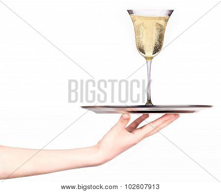 Waitress holding tray with glass of champagne