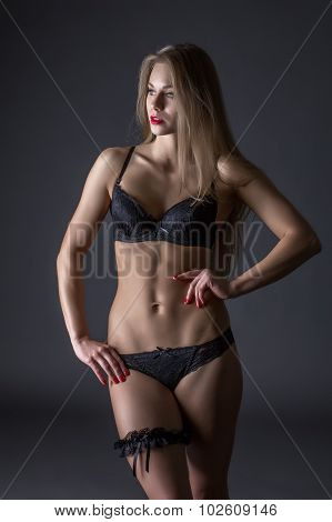 Advertising underwear. Tanned model with fit body