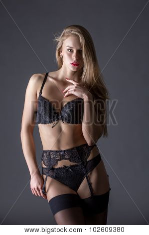 Beautiful model dressed in black erotic lingerie